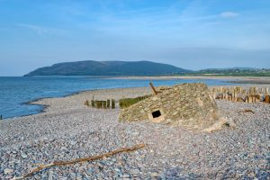 The remains of an old WWII pillbox on the beach at Porlock Weir